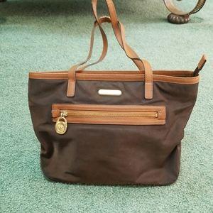 Michael Kors used nylon tote bag. Brown with gold